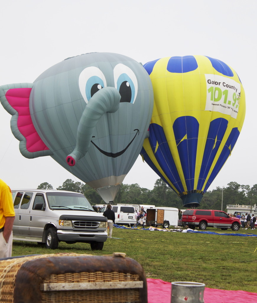 The hot air balloons being inflated.  Ella Phant in the background. Photo: Paula Bendfeldt-Diaz. All Rights Reserved.