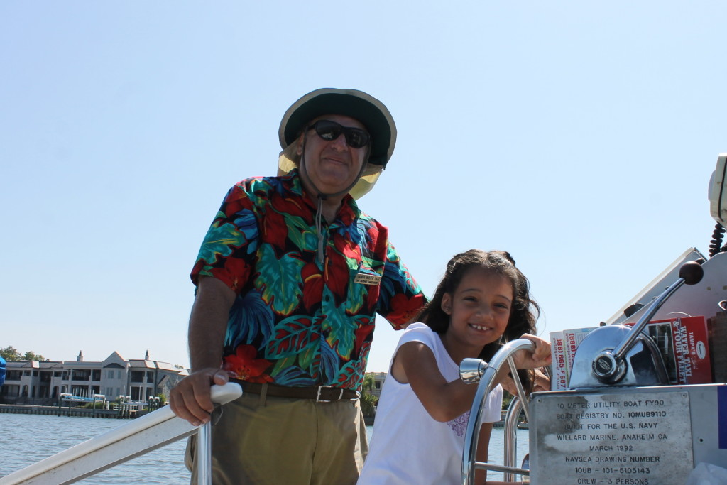 My daughter had a blast steering the boat with Captain Larry's help and ecouragement. Photo: Paula Bendfeldt-Diaz. All Rights Reserved.