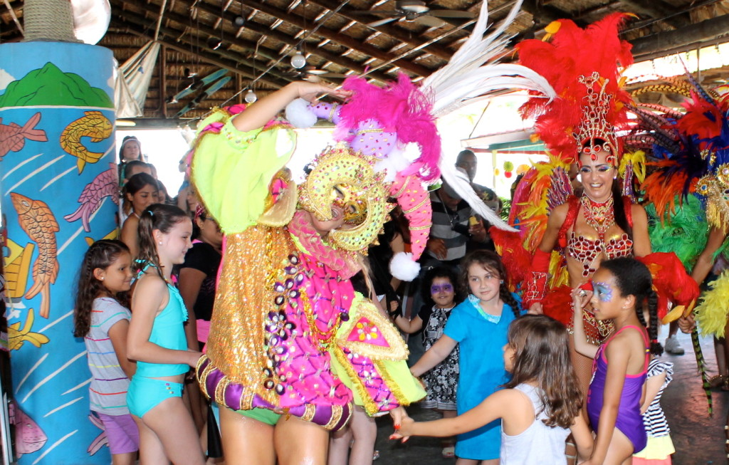 Carnaval del Mar dancers and kids joining in a colorful parade. Photo: Paula Bendfeldt-Diaz. All Rights Reserved.