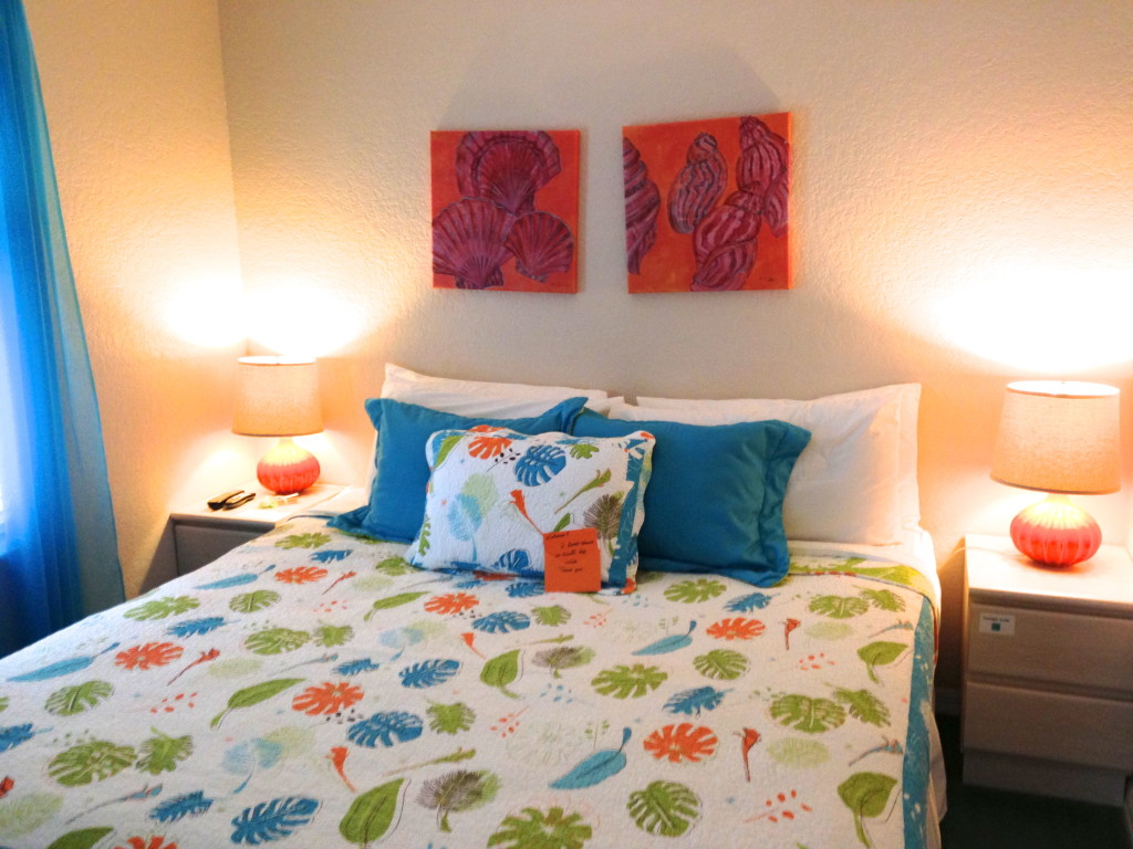 colorful bed with island motif bedspred