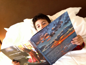 boy reading Tampa book in hotel
