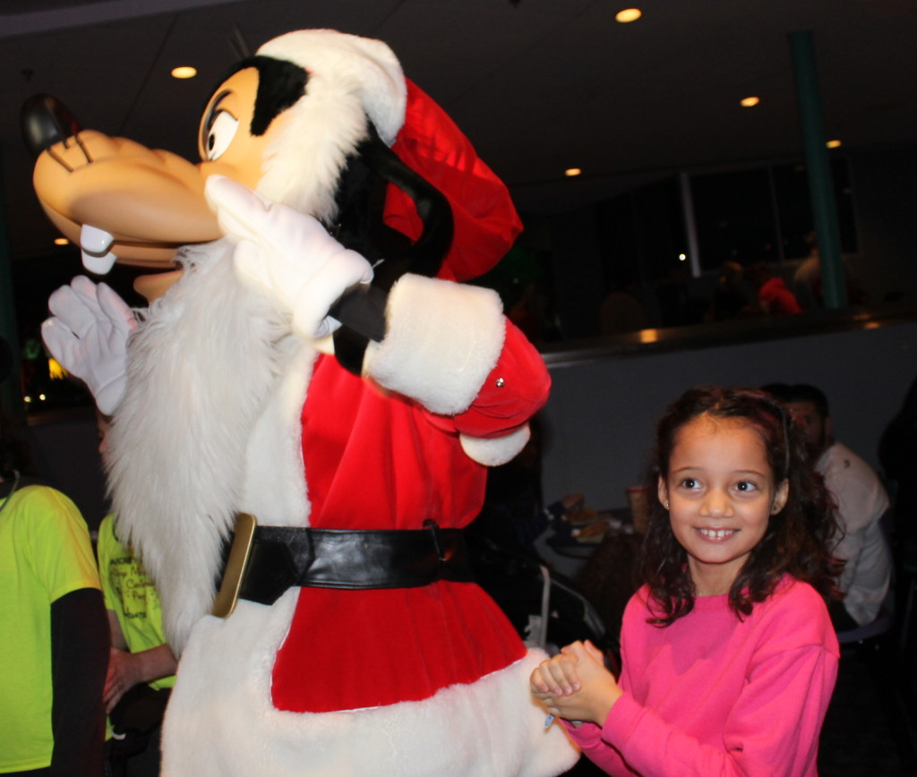 holiday party dancing with Goofy Disney