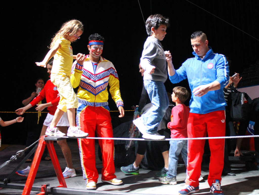 Circus heroes walking the low wire