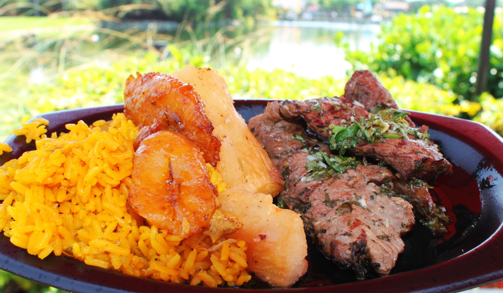Platanos maduros, yuca, tostones and arroz con gandules accompany delicious carne asada with chimichurri sauce.