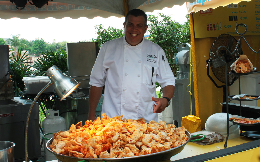 Chef Colón showing off a mountain of chicharrones at Viva la Musica in SeaWorld,