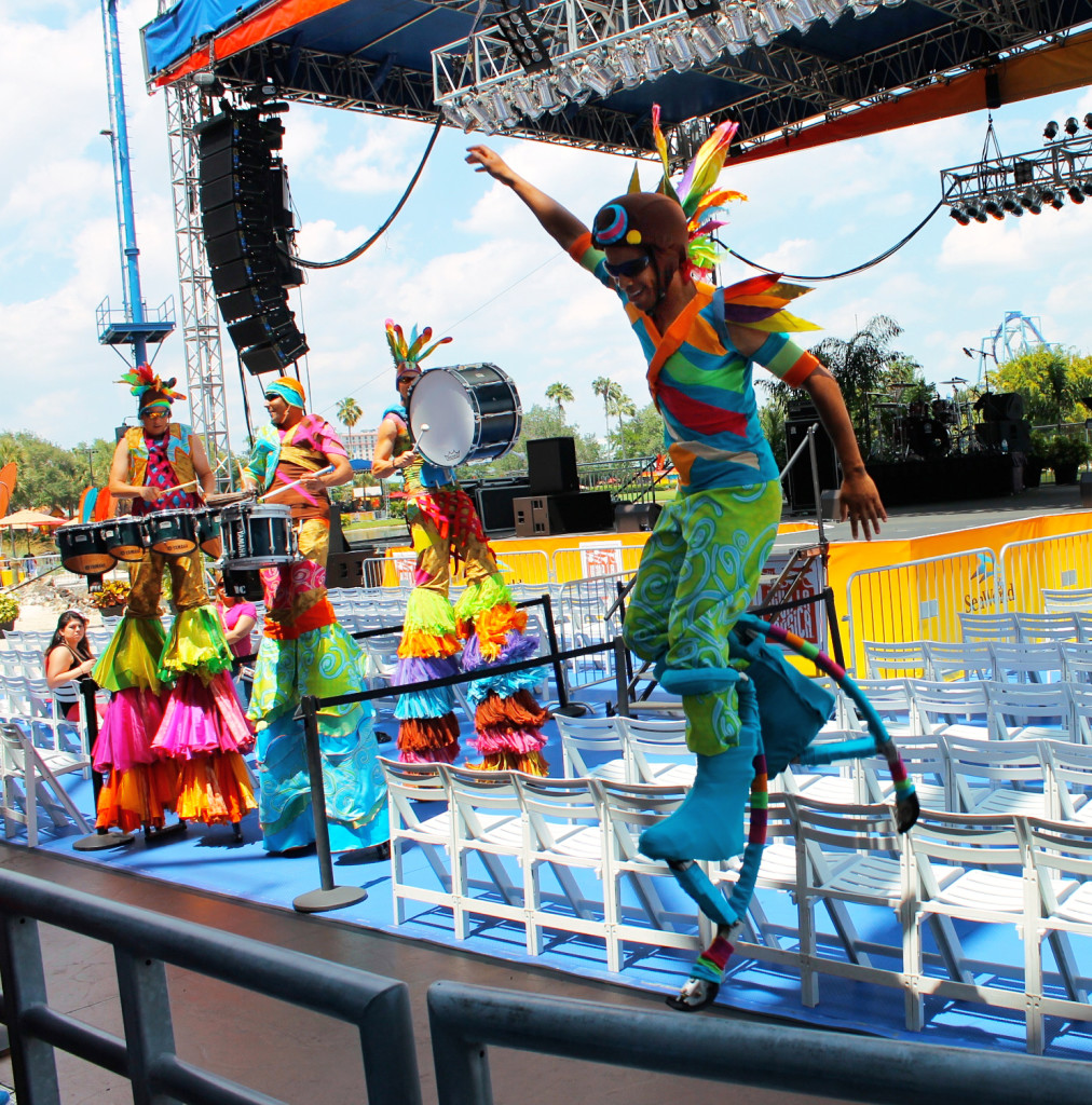 Performers playing music on stilts during Viva la Musica festiva Latino SeaWorld