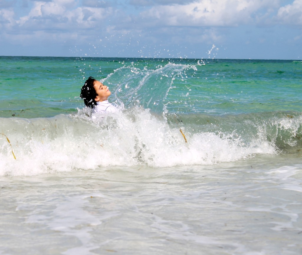 boy playing in the waves Anna Maria Island
